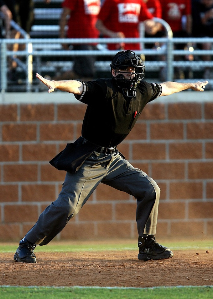"Baseball Umpire says, ""You're Safe!"" (State Gaming Regulations)."