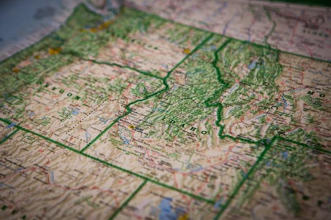 Idaho's distinctive shape shares a border with Canada.
