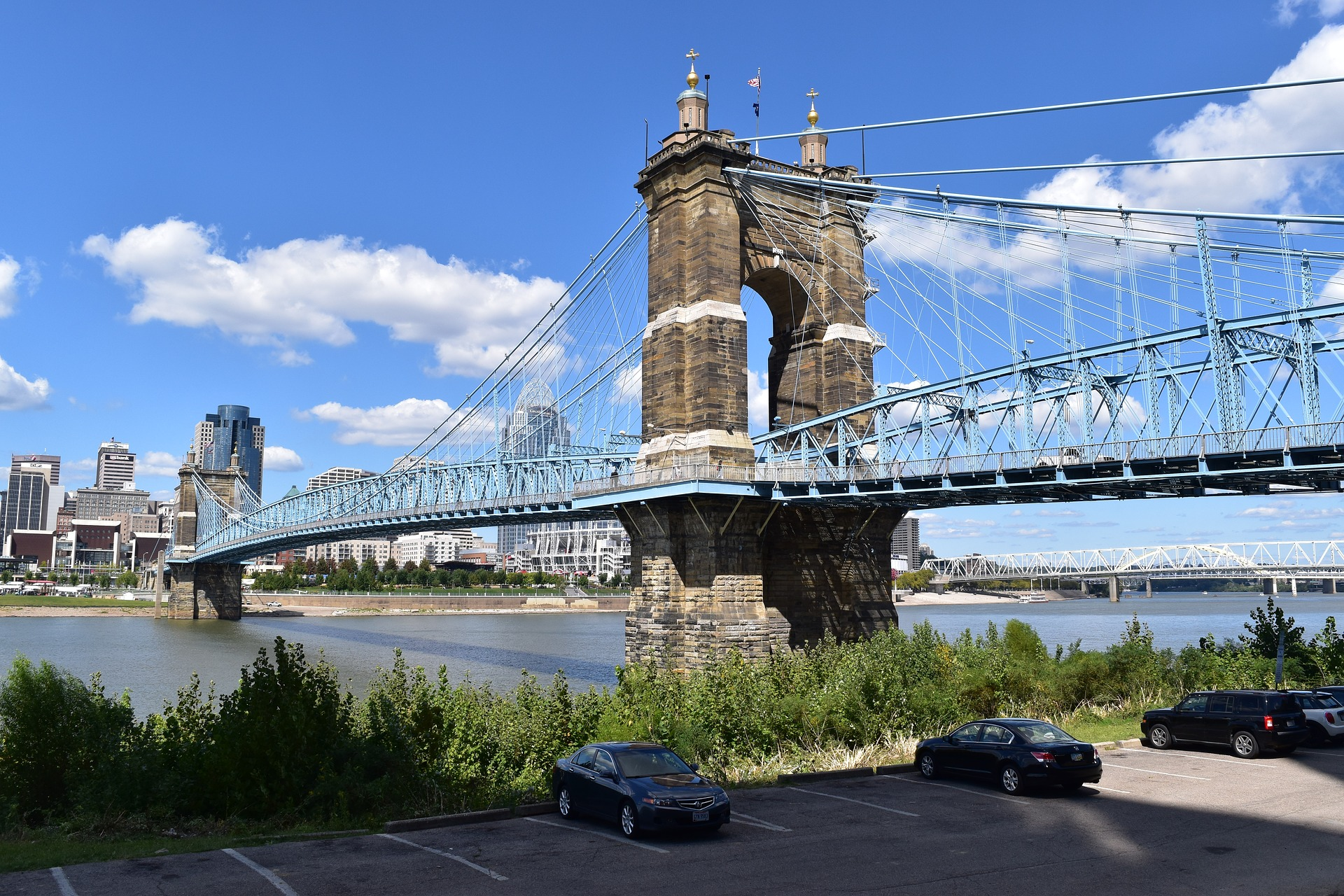 Roebling Suspension Bridge in Newport, Kentucky and historic Kentucky Slot Machine Casino Gambling.
