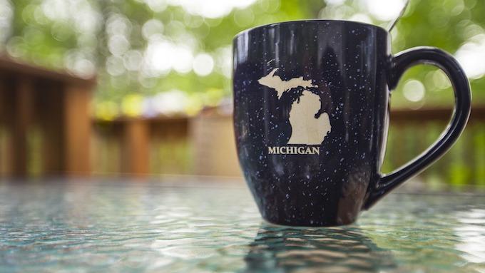 Michigan Slot Machine Casino Gambling: Tabletop counter with Michigan coffee mug.
