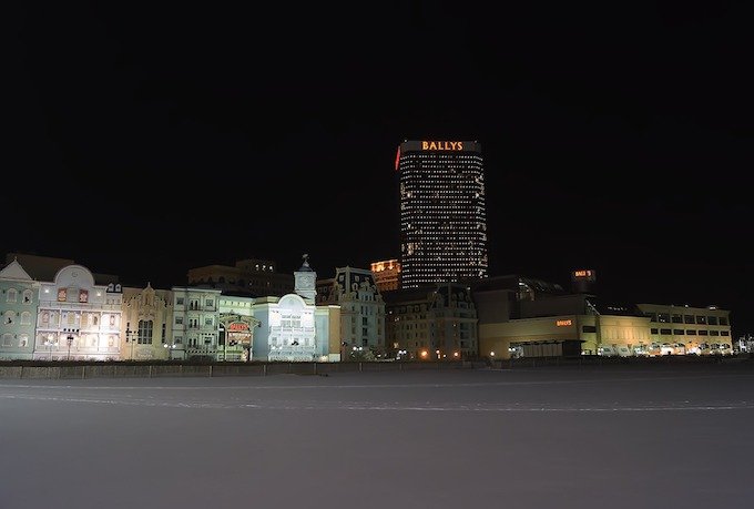 New Jersey Slot Machine Casino Gambling: Atlantic City Boardwalk at night.
