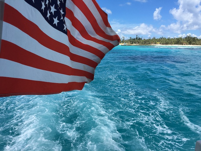 Northern Mariana Islands Slot Machine Casino Gambling: An American flag just offshore from Saipan.