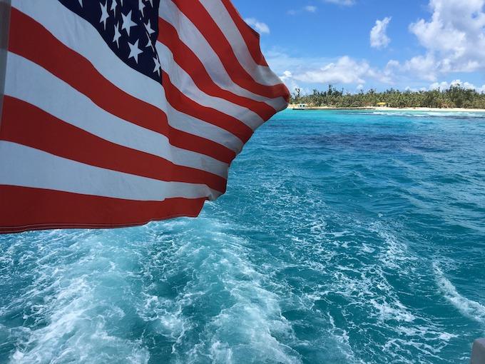 Northern Mariana Islands Slot Machine Casino Gambling: An American flag just offshore from Saipan.