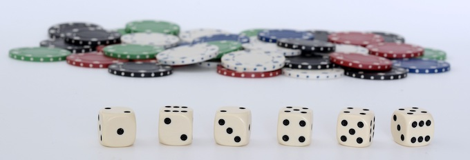 White Gambling Dice and Multi-Colored Chips [American Casino Guide 2019]