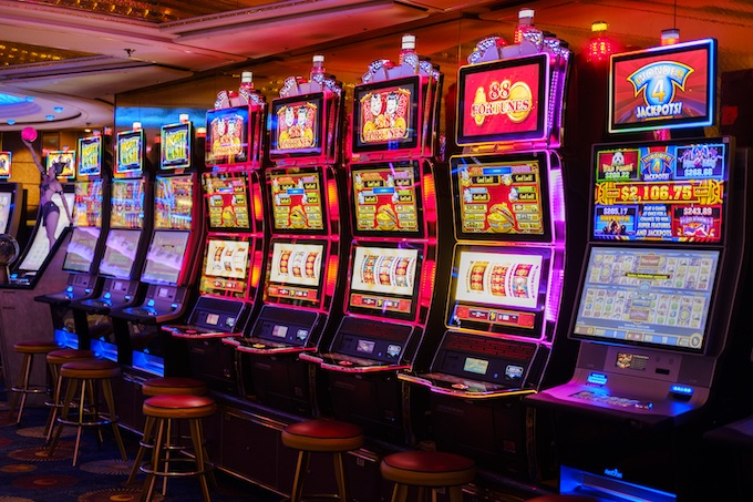 A Bank of Progressive Slot Machines [Reviewing Peter Liston]